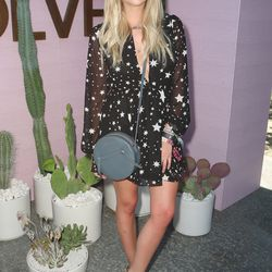 Ashley Benson in a Lovers + Friends dress, Raye sandals, Donatienne bag, and Perverse sunglasses.