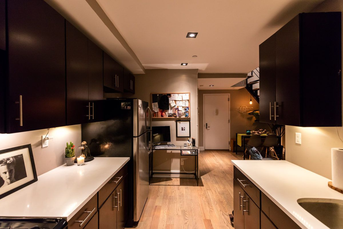 The kitchen along with the living and dining areas are located on the lower level in this loft, while the bedroom is on top. Both floors have small balconies that look onto to the back of the building.
