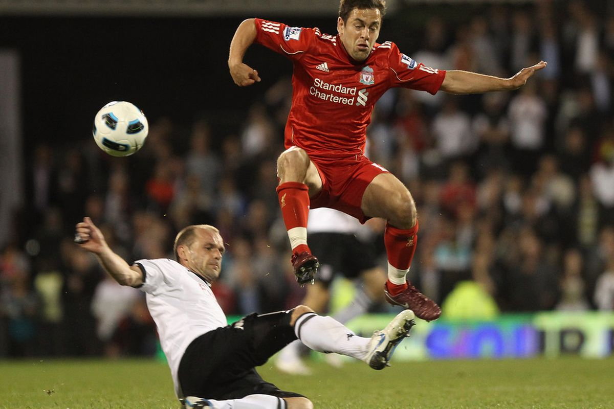 LONDON, ENGLAND - MAY 09: Danny Murphy of Fulham tackles Joe Cole of Liverpool during the Barclays Premier League match between Fulham and Liverpool at Craven Cottage on May 9, 2011 in London, England.  (Photo by Scott Heavey/Getty Images)