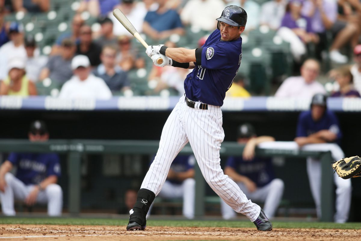 August 29, 2012; Denver, CO, USA; Colorado Rockies center fielder Tyler Colvin (21) hits a single during the fifth inning against the Los Angeles Dodgers at Coors Field.  Mandatory Credit: Chris Humphreys-US PRESSWIRE