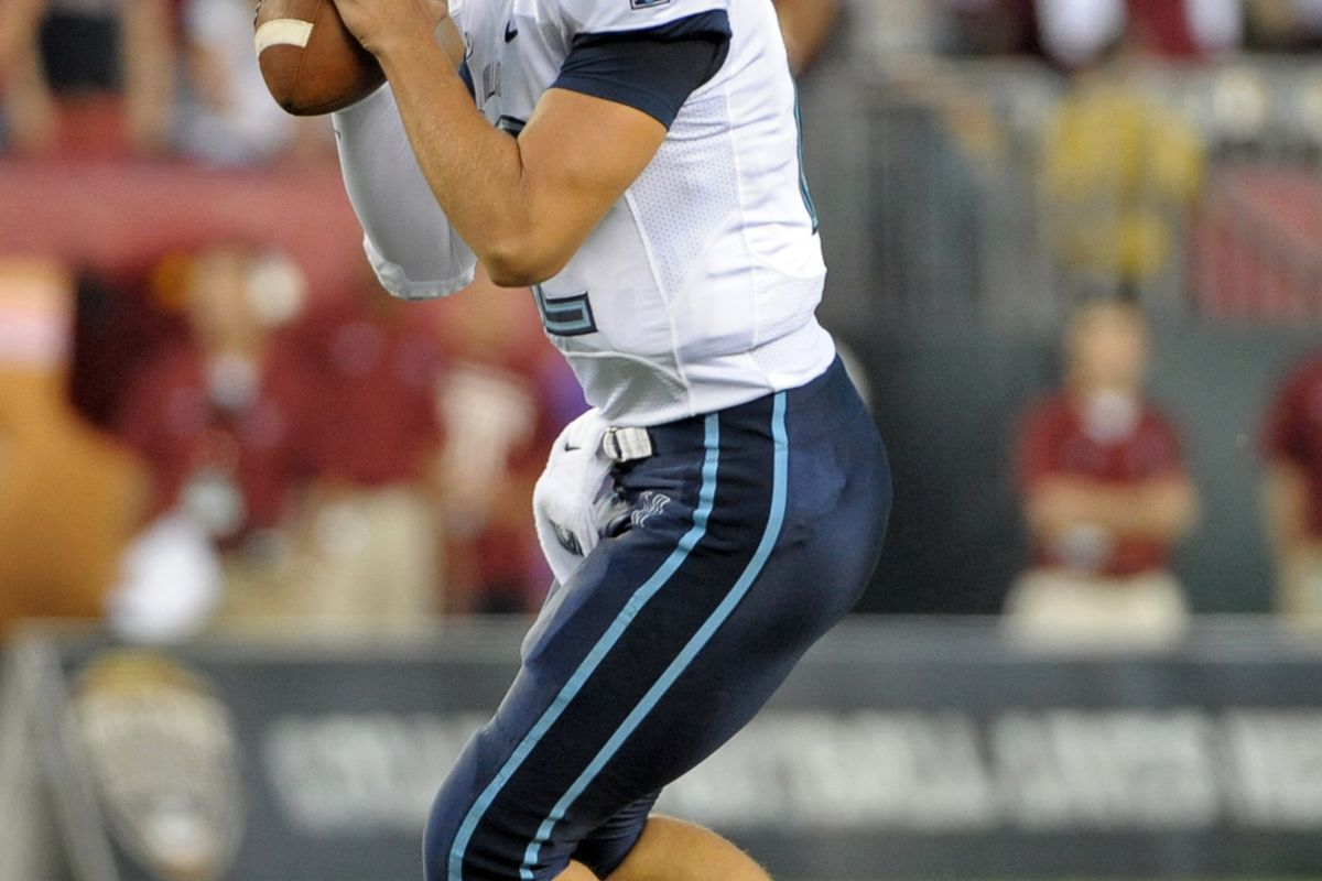 August 31, 2012; Philadelphia, PA, USA; Villanova Wildcats quarterback Chris Polony (12) drops back to pass during game against the Temple Owls at Lincoln Financial Field. Mandatory Credit: Eric Hartline-US PRESSWIRE