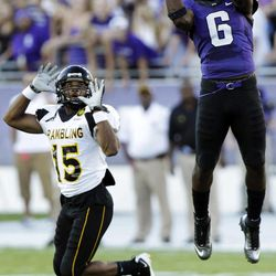TCU safety Elisha Olabode (6) intercepts a pass in front of Grambling State wide receiver Jeremy Hernandez (15) during the first half of an NCAA college football game in Fort Worth, Texas, Saturday, Sept. 8, 2012. Olabode returned the turnover for a touchdown.