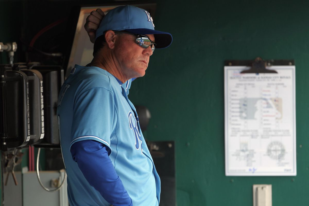 """Ned Yost prepares to write """"Eric Hosmer"""" in his lineup card. (Photo by Jamie Squire/Getty Images)"""
