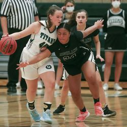 Highland's Sosefina Langi, right, gets called for a foul while trying to steal the ball from Olympus guard Olivia Rosvall during a game at Olympus High School in Holladay on Tuesday, Jan. 5, 2021.