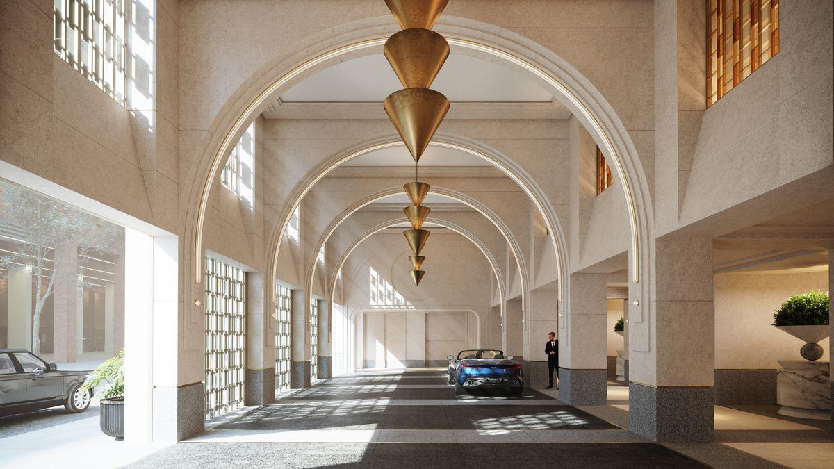 A porte cochère with several arched columns.
