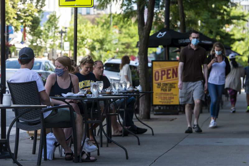 People dine on the sidewalk at Yellowtail Sushi Bar & Asian Kitchen last June.