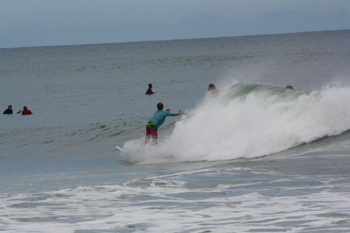 Doyle Nielsen surfs a wave at New Smyrna Beach in Florida on Sept. 9.