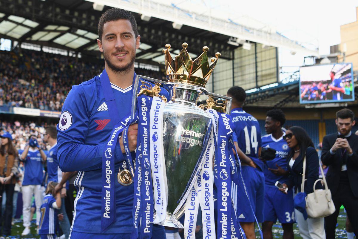 Eden Hazard holding the Premier League trophy following the 2016-17 season
