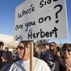 Neldon Wilson, left, chants along with Marlene Wilson, right, during a rally asking Utah Gov. Gary Herbert to shut down Stericycle's medical waste incinerator in North Salt Lake on Thursday, Sept. 25, 2014.