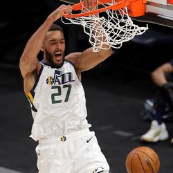 Utah Jazz center Rudy Gobert (27) dunks the ball as the Utah Jazz and the Memphis Grizzlies play in game one of their NBA playoff series at Vivint Arena in Salt Lake City on Sunday, May 23, 2021. Memphis won 112-109.