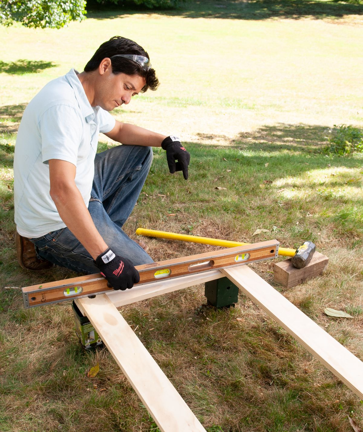 Man Levels And Squares Post Anchors For Arbor Bench