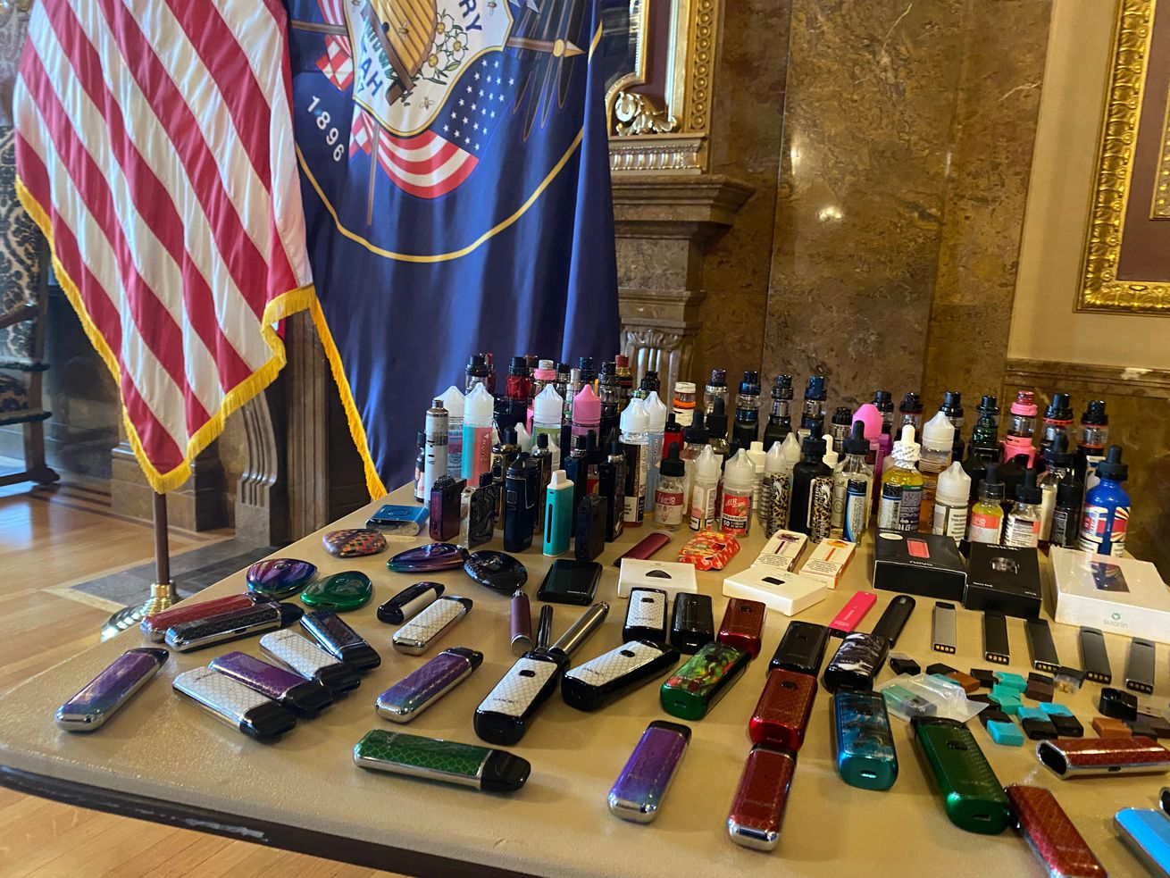 Electronic cigarette devices and cartridges are displayed during a press conference about vaping at the Capitol in Salt Lake City on Wednesday,Jan. 29, 2020.