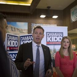 Damian Kidd and his wife stand at their booth talking to supporters while campaigning for the vote of Republican delegates at Timpview High School in Provo on Saturday, June 17, 2017.