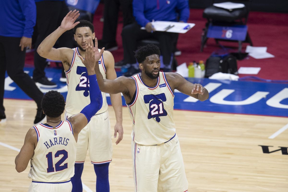 Tobias Harris, Joel Embiid, and Ben Simmons of the Philadelphia 76ers react against the Brooklyn Nets at the Wells Fargo Center on April 14, 2021 in Philadelphia, Pennsylvania.