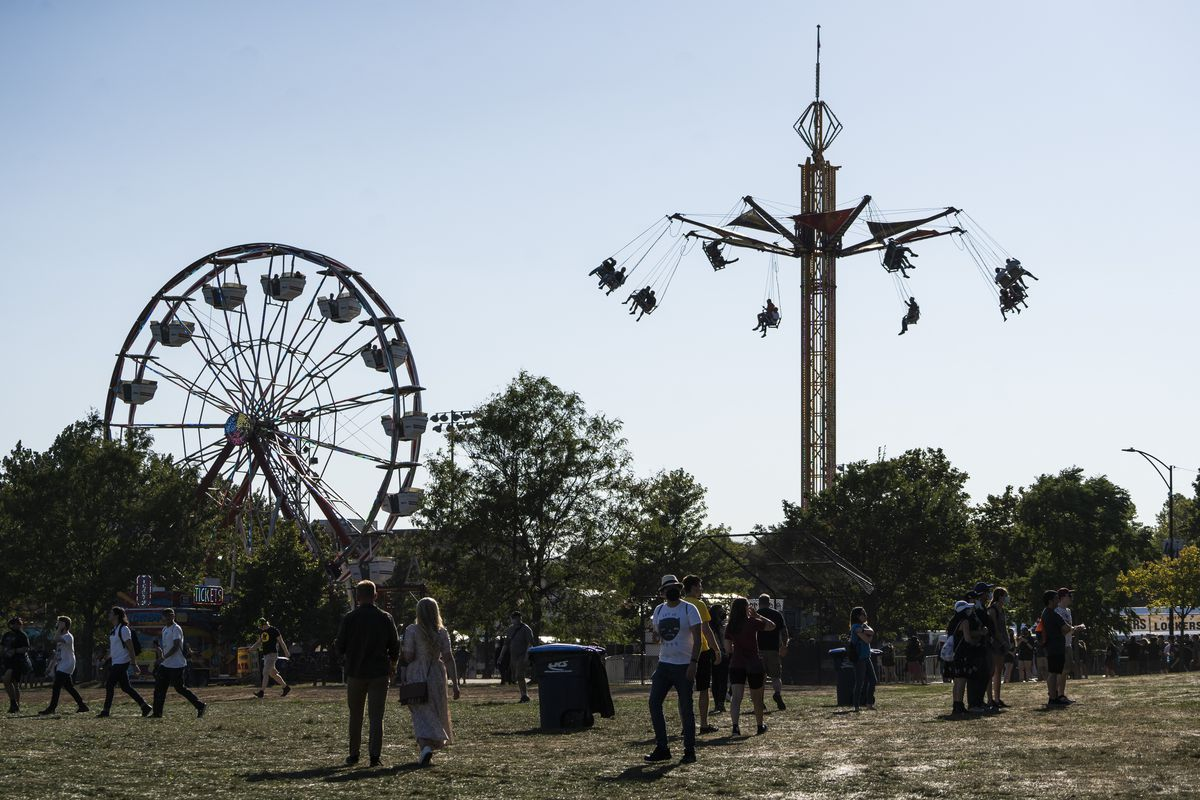 Fans head to the carnival at Riot Fest on Day 1 of the event in Douglass Park.