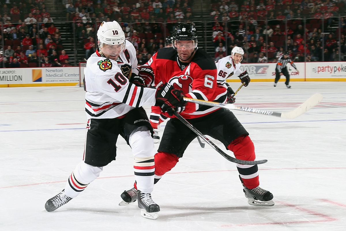 Get ready for a lot of this: A Devil just a bit too late at defending a Blackhawk, who just took a shot.