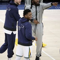 Utah Jazz forward Joe Ingles (2), Utah Jazz guard Donovan Mitchell (45) and former Jazz player and current Phoenix Suns forward Jae Crowder chat after a preseason NBA game at the Vivint Smart Home Arena in Salt Lake City on Monday, Dec. 14, 2020. The Jazz beat the Suns 111-92.