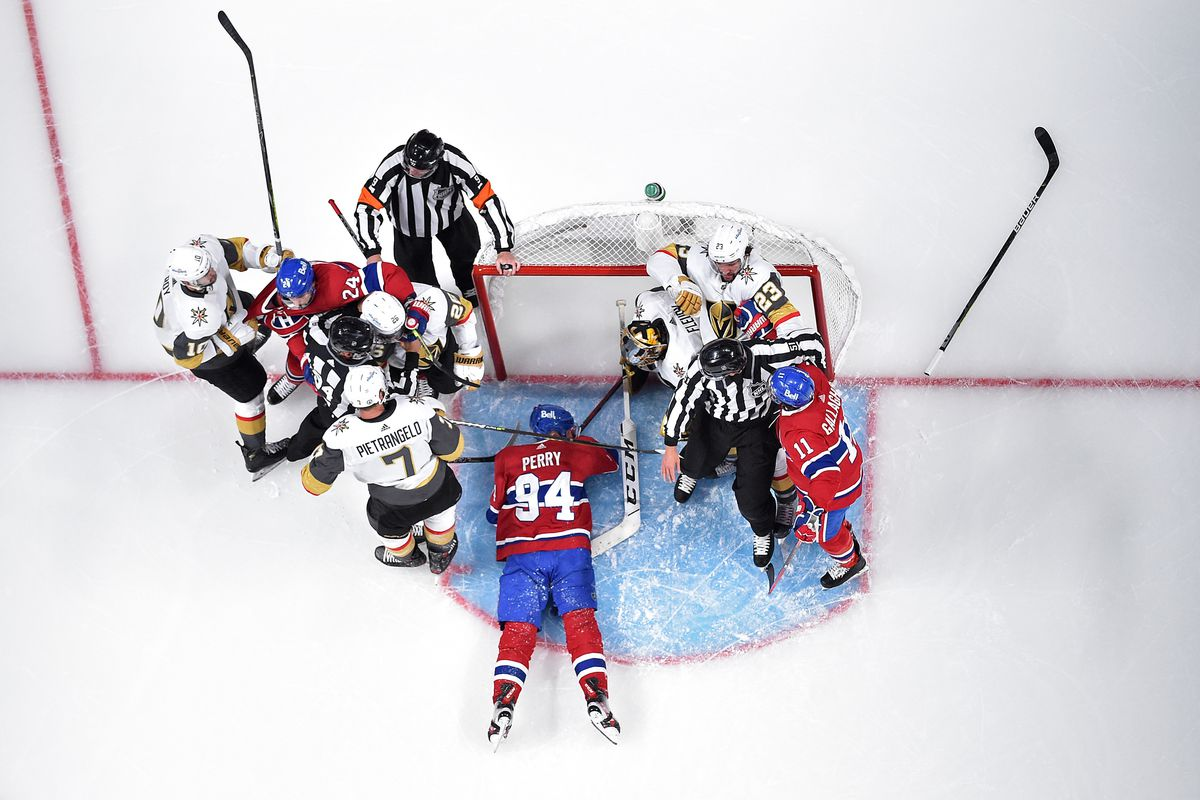 Corey Perry #94 of the Montreal Canadiens gets tripped up against the Vegas Golden Knights as players scuffle during the first period in Game Three of the Stanley Cup Semifinals of the 2021 Stanley Cup Playoffs at Bell Centre on June 18, 2021 in Montreal, Quebec.