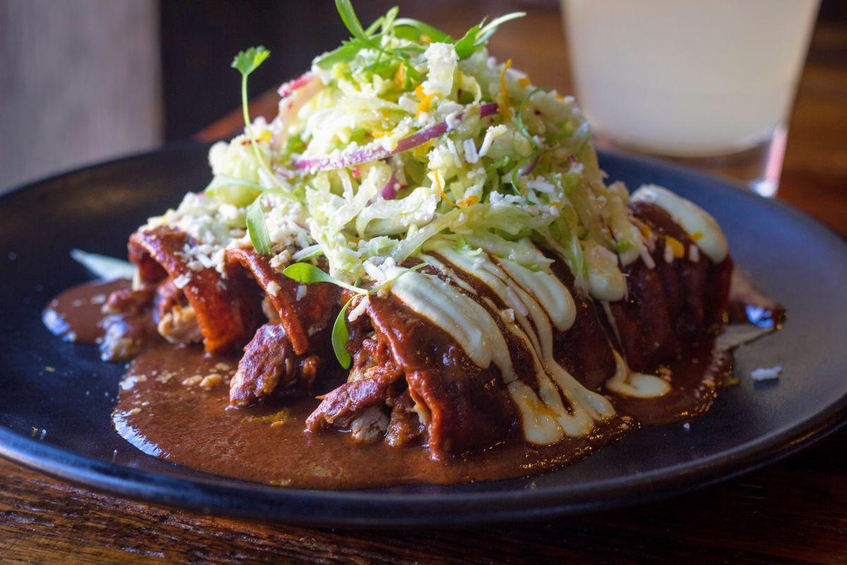 enchiladas on a blue plate