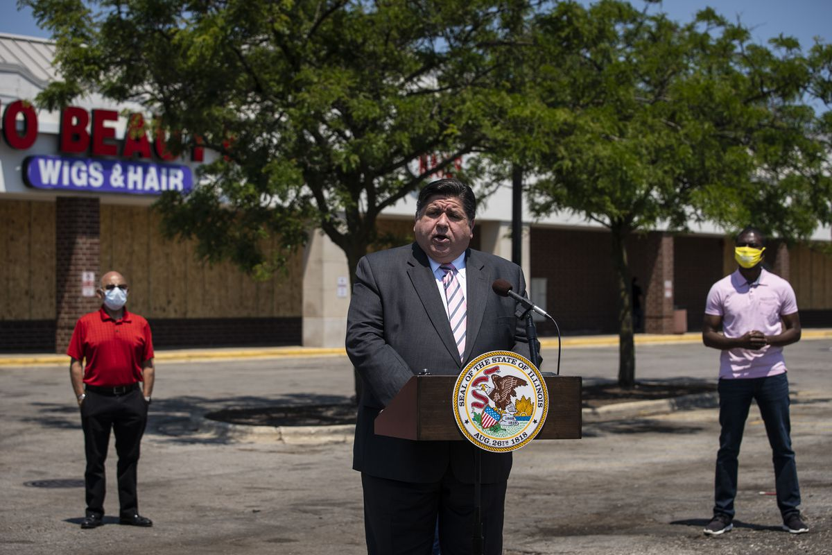 Gov. J.B. Pritzker announces grants intended to help businesses impacted by the coronavirus pandemic during a news conference on the West Side in June.