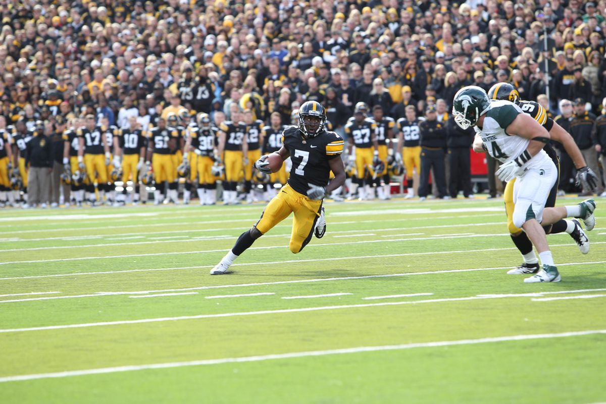 IOWA CITY, IA - NOVEMBER 12: Marvin McNutt, Jr. #7 of the Iowa Hawkeyes is pursued by Marcus Rush. We will miss this man.   (Photo by Reese Strickland/Getty Images)