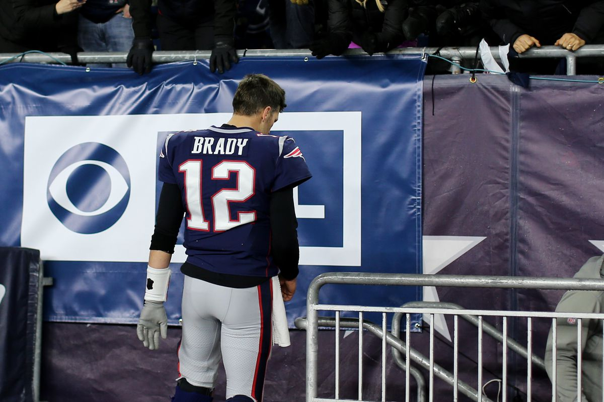 Tom Brady of the New England Patriots walks into the locker room during halftime of the AFC Wild Card Playoff game against the Tennessee Titans at Gillette Stadium on January 04, 2020 in Foxborough, Massachusetts.
