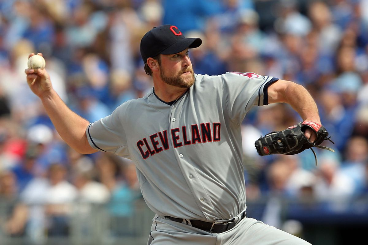 KANSAS CITY, MO - APRIL 13:  Starting pitcher Derek Lowe #26 of the Cleveland Indians pitches during the Kansas City Royals home opener on April 13, 2012 at Kauffman Stadium in Kansas City, Missouri.  (Photo by Jamie Squire/Getty Images)