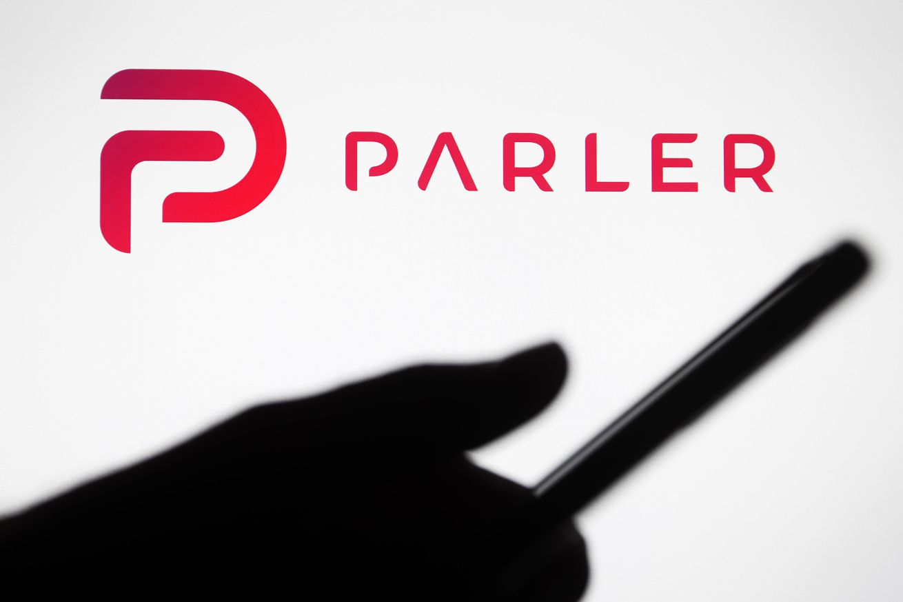 In this photo illustration the Parler logo seen in front of...