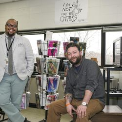 """High school teachers, Ronell Whitaker, left, and Eric Kallenborn, right, who started the Comic Education Outreach program that is partnered with Pop Culture Classroom, pose for a portrait at Alan B. Shepard High School in Palos Heights, Illinois, on Tuesday, April 4, 2017. CEO is non-profit lending library for teachers across the country to """"engage (students) immediately and encourages visual literacy"""" through graphic novels and comic books, says Kallenborn."""