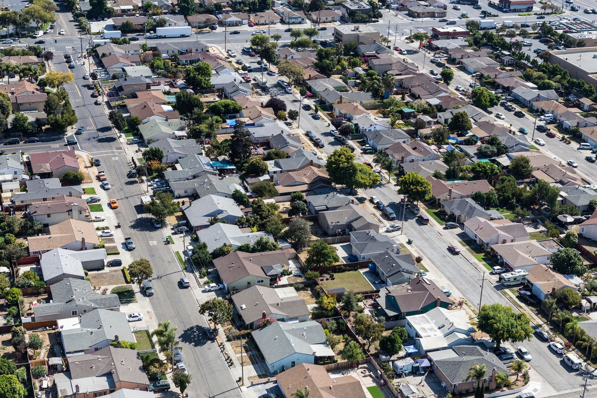 An aerial view of single-family homes in a neighborhood.