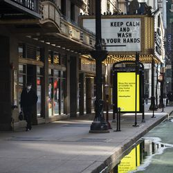"""""""Keep calm and wash your hands"""" written on the marquee at the James M. Nederlander Theatre, 24 W. Randolph St., in the Loop during the coronavirus pandemic, Monday afternoon, April 6, 2020."""