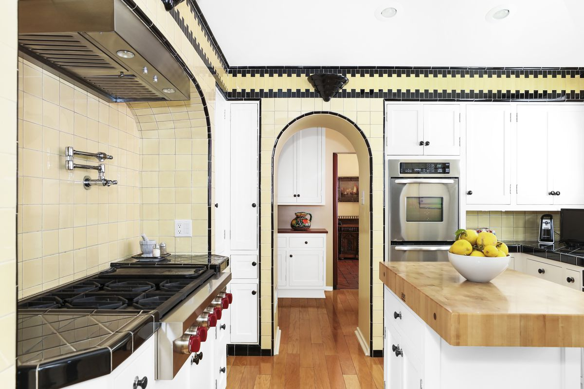 A kitchen with a double oven and a large center island
