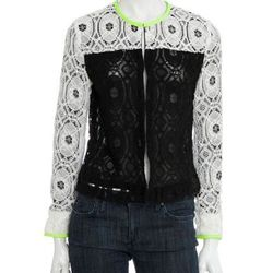 Lace is a trend that will stick around for Spring. Pair this chic jacket with a black A-line skirt and tights now, and with a white jean in the Spring! Lace Colorblock Jacket, $245. scoopnyc.com