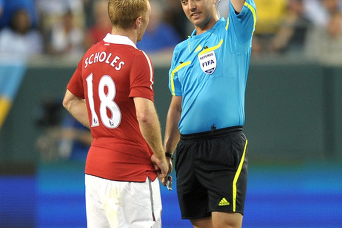 Yellow cards: Paul Scholes adds one to his collection.