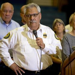Prescott Fire Chief Dan Fraijo answers questions during a news conference, Monday, July 1, 2013 in Prescott, Ariz. The bodies of 19 members of an elite firefighting crew killed after being overrun by an Arizona wildfire have been retrieved from the mountain where they died. Fraijo now says all 19 were from the Prescott-based Granite Mountain Hotshots. Authorities earlier said one of the men wasn't a crew member.  (AP Photo/Julie Jacobson)