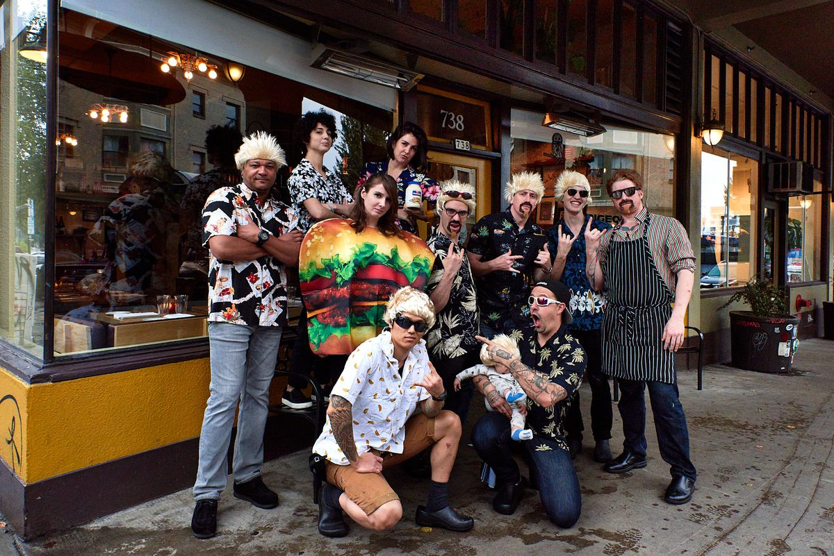 Restaurant employees dressed up as Guy Fieri