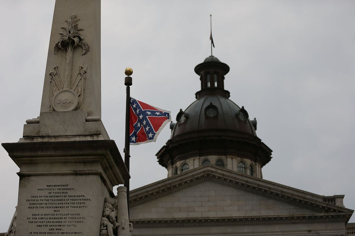 The Confederate flag flies on the Capitol grounds after South Carolina Gov. Nikki Haley announced that she will call for the Confederate flag to be removed on June 22, 2015, in Columbia, South Carolina.