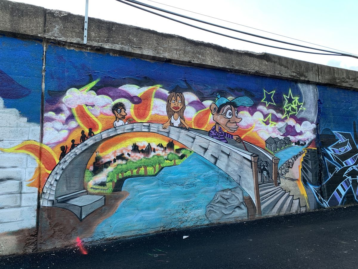Artist Max Villarreal says his aim with this piece, depicting a diverse group crossing a bridge, was to show a connection to the surrounding community. Though he has helped bring in artists to do the murals in a five-block stretch of Edgewater alleys, this is one of a few murals he did himself.