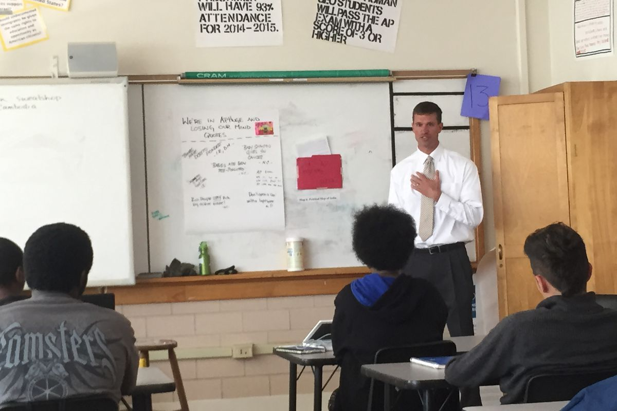 Students in an A.P. Human Geography class at Manual High School ask Kurt Dennis questions about his interest in replicating McAuliffe International Middle School, where he is principal, in the Manual building.