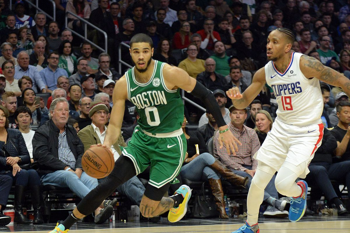 Boston Celtics forward Jayson Tatum moves to the basket against Los Angeles Clippers guard Rodney McGruder during the second half at Staples Center.
