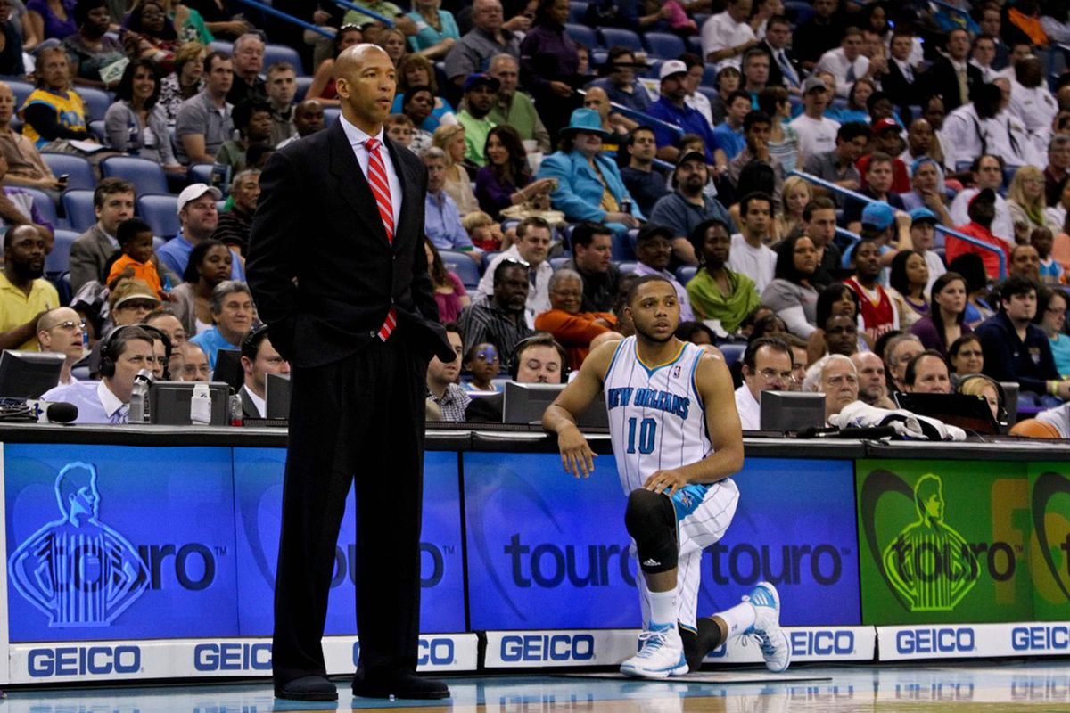 April 19, 2012; New Orleans, LA, USA; New Orleans Hornets head coach Monty Williams and shooting guard Eric Gordon (10) during the first half against the Houston Rockets at the New Orleans Arena.   Mandatory Credit: Derick E. Hingle-US PRESSWIRE