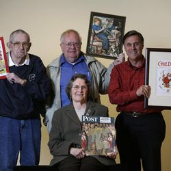 Models who modeled for Norman Rockwell illustrations pose with the pieces in which they were featured at the Bennington Museum on Friday, Sept. 28, 2012, in Bennington, Vt. From left is Butch Corbett, Tom Paquin, Don Trachte and seated is Mary Immen Hall.