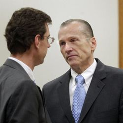 Defense attorney Randall Spencer, left, talks to Martin MacNeill before giving closing arguments in the murder trial of the former Pleasant Grove physician in Provo's 4th District Court on Friday, Nov. 8, 2013. MacNeill is charged with murder in the 2007 death of his wife, Michele MacNeill.