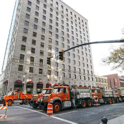 Dump trucks are lined up end-to-end outside the Hotel Monaco on Second South and Main in Salt Lake City on Monday, Oct. 5, 2020. Vice President Mike Pence is expected to stay at the hotel after arriving in Salt Lake City later Monday for Wednesday's debate with Democratic nominee Sen. Kamala Harris.