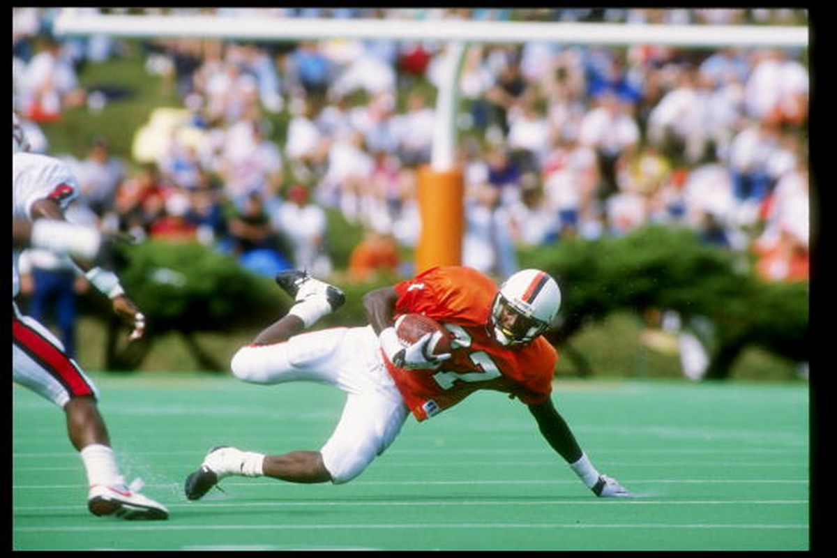 13 Oct 1990: Wide receiver Herman Moore of the Virginia Cavaliers dives for the ball during a game against the North Carolina State Wolfpack at Scott Stadium in Charlottesville, Virginia. Virginia won the game 31-0.
