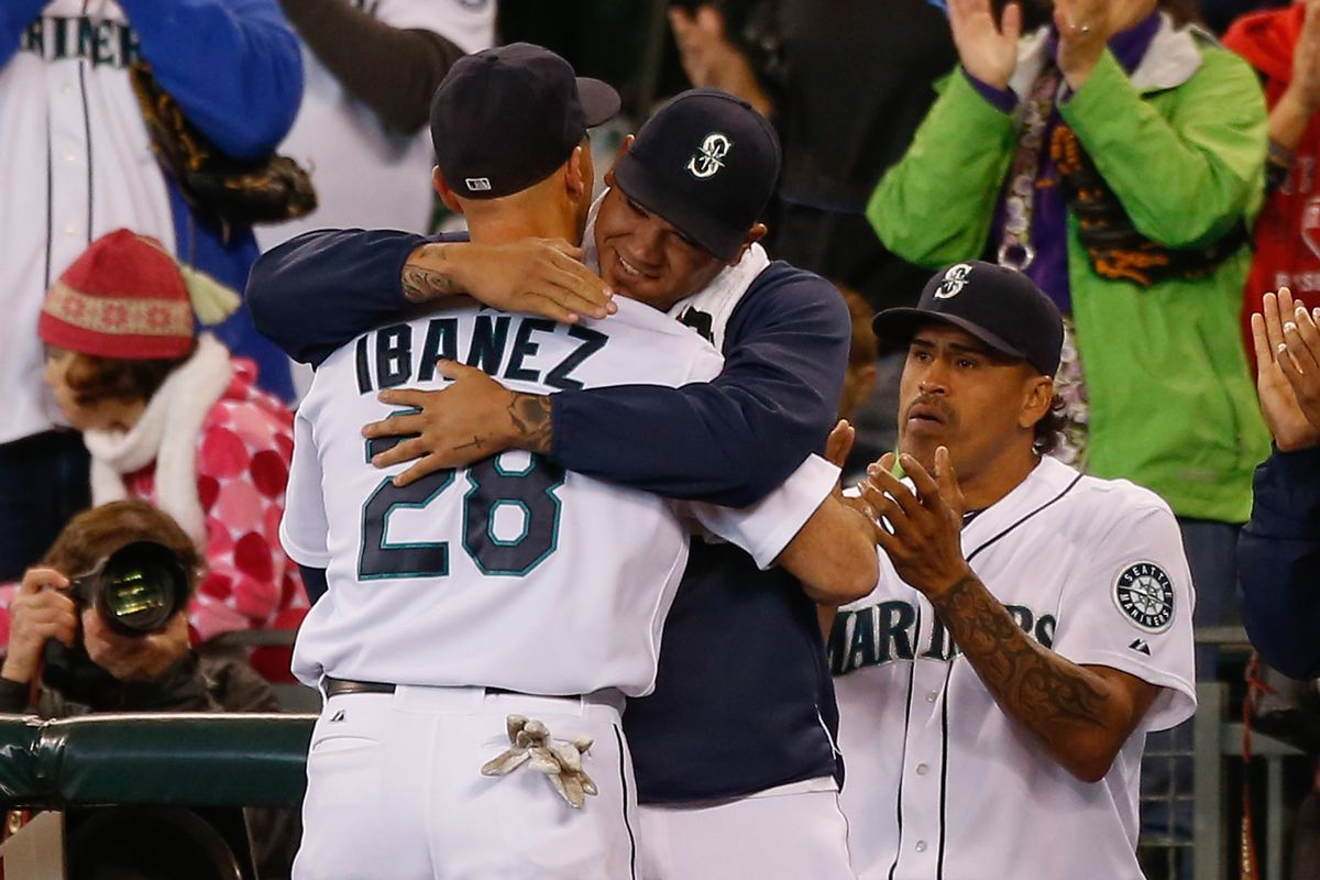 While appearing in what is likely to be his last game as a Seattle Mariner, Henry Blanco applauds someone younger than him.