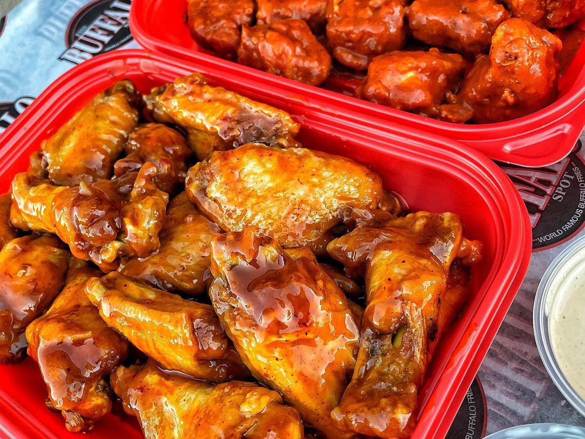 Two red baskets filled with chicken wings.