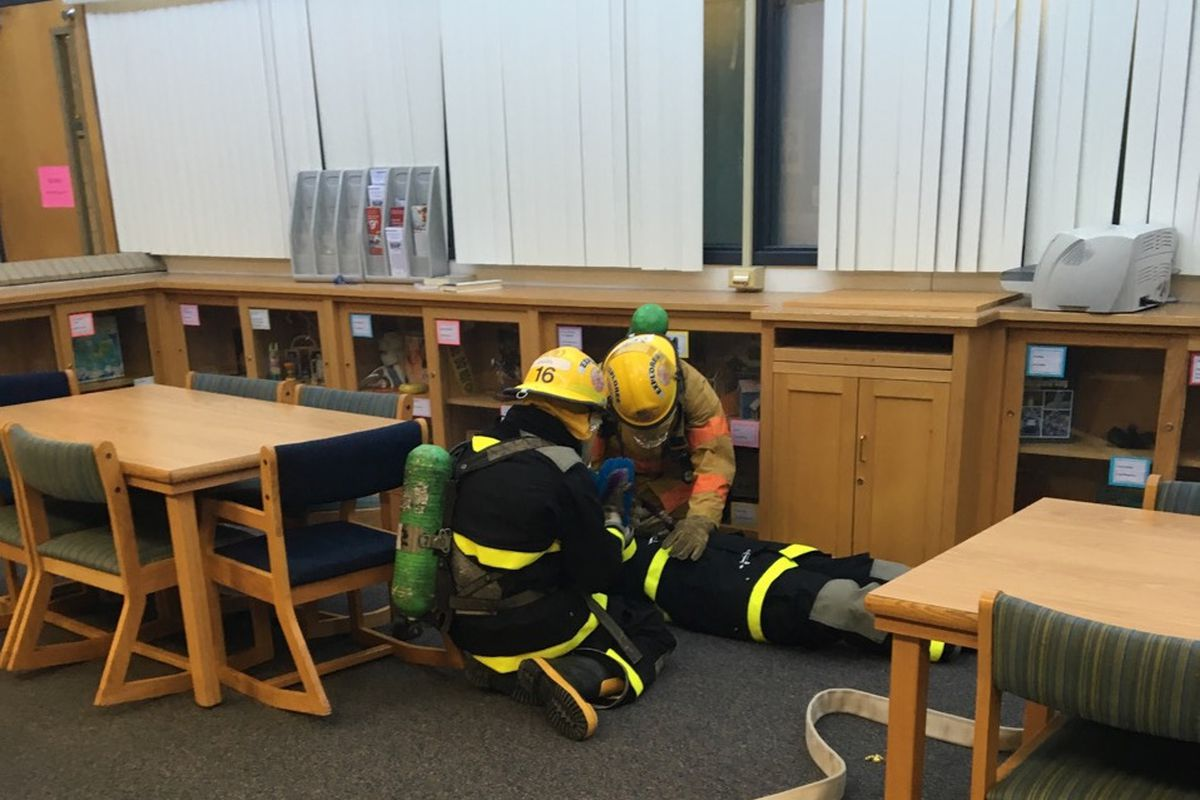 Students at CEC Early College in Denver practice a rescue in full firefighter gear.