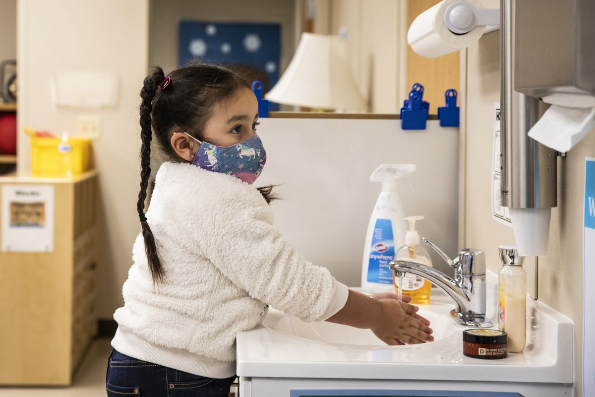 A preschool student washes her hands before breakfast at Dawes Elementary School at 3810 W. 81st Pl. on the Southwest Side,