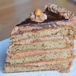 A daily selection of cakes, like this hazelnut-chocolate wonder, are provided by Petite Sweets.
